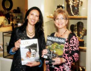 Trish Langfitt of LuxLife Media & Tara Vooris of Gumps browsing copies of LuxLife Magazine