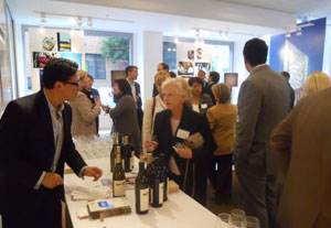 Joshua Carbajal (Robert Mondavi Winery) pouring for Angela Wood (Pacific Union GMAC Real Estate)