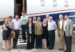 Council members representing Bombardier Flexjet gather around a Flexjet Challenger 300 aircraft, a member of the Flexjet fleet.